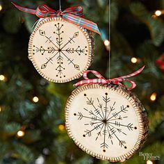 Turn wood slices into charming rustic Christmas ornaments. We started with wooden coasters, but you can also use slices found at crafts stores. Freehand-draw a snowflake design with a woodburning tool, or follow these easy steps. First, mark the center of the wood slice with a pencil. Use a ruler to draw a plus sign and then an X (like a compass). Trace the lines with a woodburning tool. Make short lines with a straight tip and press into wood. Use the same tip to burn lines around the edge…