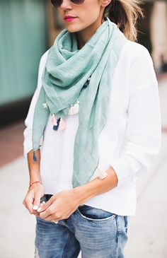Distressed jeans & tassel scarves are a do for spring style. Prepaganda & hellofashionblog.com