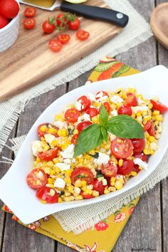 Sautéed Corn with Tomatoes, Feta and Basil is the perfect side dish with plenty of savory flavors!