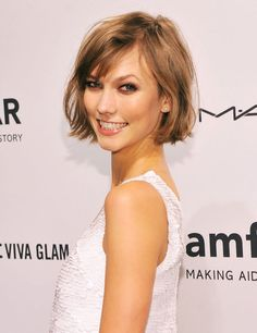Yet another picture of Karlie's cute, choppy little bob. Summer cut? Maybe, just maybe.