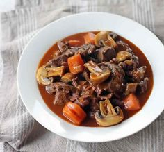 Beef Bourguignon or Beef Burgundy a traditional French stew made out of beef braised in red wine together with garlic, onions, carrots, bouquet garni, pearl onions and mushrooms. Entree Recipes, Asian Recipes, Beef Recipes, Soup Recipes, Cooking Recipes, Ethnic Recipes, Sandwich Recipes, Yummy Recipes, Dinner Recipes