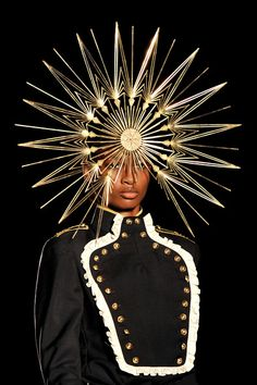 A model showcases designs on the catwalk by Philip Treacy on day 3 of London Fashion Week Spring/Summer 2013, at The Royal Courts Of Justice...