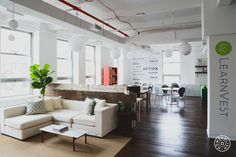 LearnVest - The space is divided into two different areas: the work area has long rows of workstations