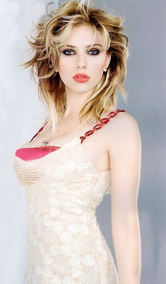 Scarlett Johansson. Love her wild style hair.  Gorgeous makeup. Great body.