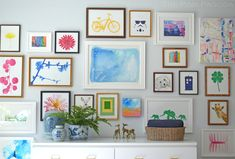 colorful gallery wall via The Pink Pagoda