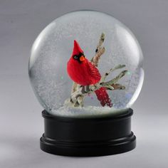 Add the magic of the season to your home with this Cardinal Snow Globe.