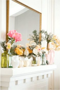 Stunning floral display on a mantle. Great idea for spring decor.