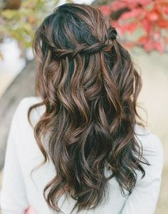 Go boho chic with tousled waves and a waterfall braid!