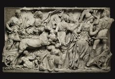A MARBLE MYTHOLOGICAL SARCOPHAGUS PANEL OF THE RAPE OF PERSEPHONE, ROMAN IMPERIAL  ,  CIRCA A.D. 190-200    carved with Demeter holding a torch and drivinga two-horse chariot, Iris in the background with billowing drapery, a reclining figure of Tellusbelow, Persephone kneeling in the foreground gathering flowers in a basket, and a group of goddesses, Aphrodite, Artemis, and Athena attempting to restrain Ha