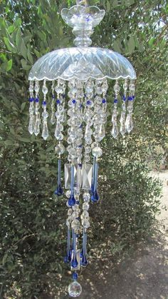 17 Best images about DIY - Wind Chimes, Spinners & Rain . Crystal Wind Chimes, Glass Wind Chimes, Diy Wind Chimes, Glass Garden Art, Garden Whimsy, Hanging Crystals, Glass Flowers, Stained Glass Art, Bottle Art