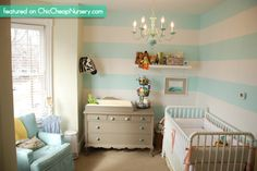 Striped Nursery Walls Aqua with white pipining,    http://www.chiccheapnursery.com/2011/real-rooms/vans-nursery-vintage-inspired-decorating-ideas/
