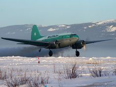 Buffalo Airlines Curtis C-46 Commando (C-FAVO) departs Norman Wells (CYVQ) for Yellowknife (CYZF) after a delivery of mail and groceries.