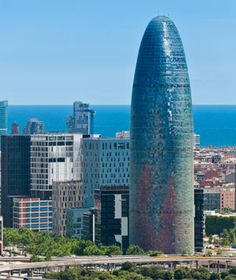 Agbar Tower, Barcelona  Barcelona's tallest landmark often draws comparisons to London's Swiss Re building, which opened a year earlier, in 2004. But designer Jean Nouvel insists his inspiration was Gaudí's Sagrada Familia.