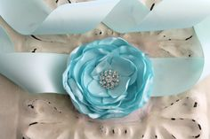 Hey, I found this really awesome Etsy listing at http://www.etsy.com/es/listing/115348914/crystal-blue-floral-sash-double-faced