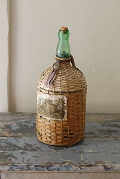 Vintage Demijohn Wine Jug with Wicker Cover and Original Label, via Etsy.