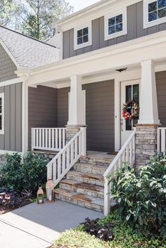 Modern Craftsman porch with stone and white accents – The Gray Cottage Front Porch Pillars, Front Porch Remodel, Front Porch Railings, Front Porch Makeover, Front Porch Design, Front Porch Deck, Deck Railings, Porch Step Railing, Porch Handrails