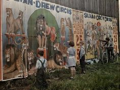 Children fascinated by a circus billboard, ca. 1930s