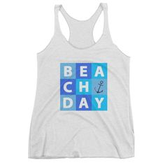 This tank shirt featuring white bold beach day letters and navy blue anchor on light blue, ocean blue and ocean green blocks is a nice choice for a beach fan wearing on a cozy relaxing summer day.…