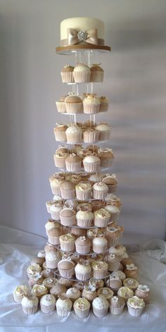 """Shabby chic wedding tower of 150 cupcake cupcakes with a 6"""" top cake."""