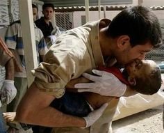Syrian kissing his dead child. This is so sad and so wrong. When is someone going to step in and stop this? Does anyone know the answer to this question? Somebody, anybody, do something soon!