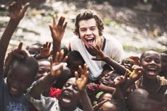 Harry styles when One Direction went to Ghana,Africa this picture makes my heart melt!