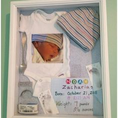 What a cute idea! A baby shadow box for all those precious keepsakes!~