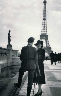 A German officer and French woman in front of the Eiffel Tower