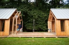 Timber and glass walls slide along runners to reveal or enclose this gabled garden shed in Eindhoven, designed and built by Caspar Schols as a hobby space for his mother.