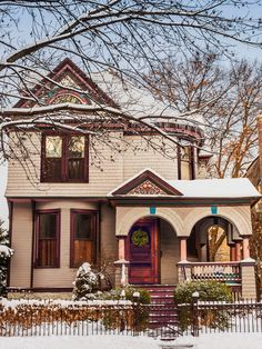 """Located in a historic district, the home was painted in seven different exterior colors by the previous owner. """"She did taupes, pink, teal, and purples,"""" says Nicole. """"I love it! It's like this storybook house I was always meant to own."""""""