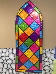 Close up photo of faux stained glass windows Grace point church abilene tx Kingdom rock vbs   Colored cellophane cut to any shape taped with black tape onto wrinkled aluminum foil that is spread flat.