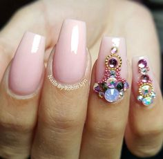 Pink nails with designs on ring and pinky finger