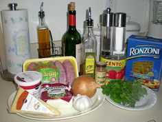 Ingredients: 1 Box of Ziti Rigati 1 lb. of Mild Italian Sausage 1 35oz. can of Plum Tomatoes 1-1/2 cups Olive Oil 1/2 cup Dry Red Wine 1...