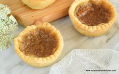 Melt-in-your-mouth Gluten Free Butter Tarts filled with a slightly gooey,but not too runny,buttery rich caramel-like filling. Lactose Free Butter, Gluten Free Pastry, Gluten Free Baking, Gluten Free Desserts, Gluten Free Recipes, Delicious Desserts, Yummy Treats, Pastry Recipes, Tart Recipes