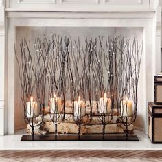 The Uttermost Fedora Candle Holder features unique metal twig branches for an elegantly rustic look. Finished in a dark brown wash and accented with clear beads Branches Allumées, Lighted Branches, Twig Lights, Art Rustique, Chimney Decor, Candles In Fireplace, Fireplace Decorations, Fireplace Ideas, Fireplace Candle Holder