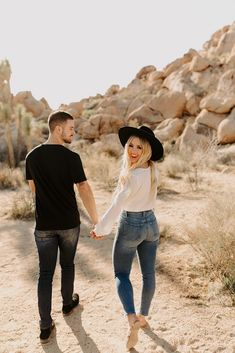 Get a glimpse inside Chris and Bre's sun-kissed and warm Joshua Tree Engagement Photos Session taken in Joshua Tree National Park, California.