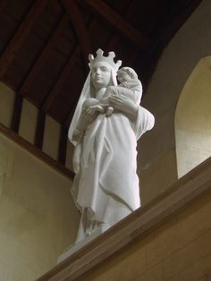 https://flic.kr/p/AbZWEg | Virgin & Child, Mount St Bernard's Abbey | Modern sculpture of the Virgin & Child over the public entrance. Pevsner mentions a Flemish sculpture of the 1500s being positioned here, but this appears to have been moved to the monastic library and replaced by this new figure. Mount St Bernard's Abbey was founded in 1835 for a community of Cistercian monks, and was the first Catholic abbey to be established in England after the Reformation. The Abbey church of M...