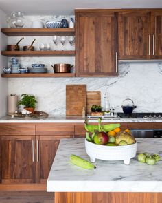 rich wood kitchen with a marble backsplash