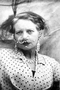 Ethel Granger – From there her husband moved on to piercing her for his own admiration and insisting she wear 5″ heels daily. He slowly enlarged piercings in her ears, septum and eventually gave her 13 piercings in total. The things women do for men amazes me!!!!!!!