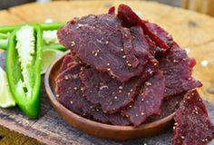 Hot & spicy jerky is the spice of life, this homemade jerky recipe will get your blood pumping, whether you're loading up for a hike or surviving in the Rockies, this jalapeno jerky recipe tastes amazing. Jerkey Recipes, Traeger Recipes, Grilling Recipes, Meat Recipes, Game Recipes, Copycat Recipes, Jalapeno Beef Jerky Recipe, Peppered Beef Jerky Recipe, Homemade Jerky