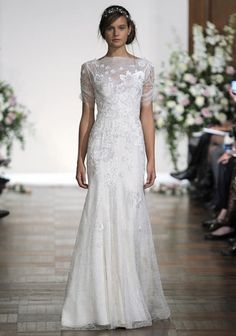 This lace bridal gown has vintage appeal---it would look right at home on the set of  Downton Abbey .    Dress by  Jenny Packham .