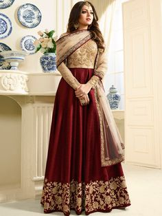 Shop Drashti Dhami maroon color silk party wear anarkali kameez online at kollybollyethnics from India with free worldwide shipping.
