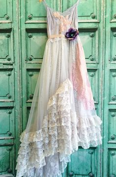 Sale- was 350$  One of a kind. The top is hand dyed pale lilac with lace , appliques and adjustable straps. The skirt is layers of lace and organza. The top layer has a wide inset of Ruffles and is draped asymmetrically. The lining and lace under layer are knee length so the dress is semi sheer from knees to hem. Pale lilac waistband with pale pink satin sash. Purple flower is removable and can also be worn in hair. Sizes all. Measurements Bust 34-36 Waist 26-31 Length 54-65