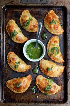 Tomato mozzarella empanadas with basil garlic sauce.