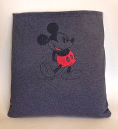 "Maybe the Disney people would like to know that this Etsyan is ""upcycling"" one of their tees into a faux vintage pillow cover, using their licensed character without permission.  Not a vintage item!"