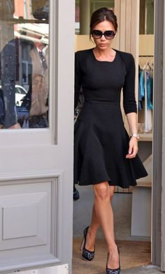 Office Wear: Victoria Beckham in Victoria Beckham dress (Spring 2010 collection) and Brian Atwood pumps