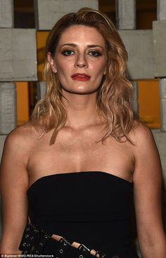 Striking:The star's blonde hair was tousled into a sexy bedhead style while her blemish-f...