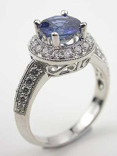 Contemporary Blue Sapphire Engagement Ring. I have always loved sapphires; my birthstone and this is such a beautiful setting!