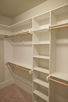 Spacious closet with built in shelves and two levels of hanging space by Lawrence Homes, Inc | Photography by One Studios :: Photography