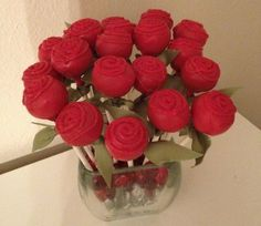 A different way of displaying cake pops - put in a vase with clear rocks