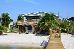 Rockport, TX: Private shelled beach and NEW private lighted fishing pier on Copano Bay behind this lovely 3 bedroom, 2 bathroom bay front home!  NEW LIGHTED FISHING ...